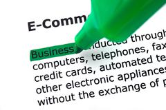 The word e-commerce, highlighted in green on white Stock Photos