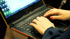Female journalist working with his laptop computer during press conference Stock Footage