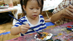 A child painting a figurine . - stock footage