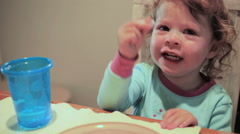 Toddler eating candies and cookies at the dinner table. Stock Footage