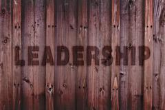 Leadership Concept Background / Leadership Word Engraved on Wood - stock illustration