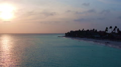 Aerial from Manchebo beach at sunset on Aruba island in the Caribbean Sea Stock Footage