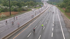 Thousands of people riding bikes on Toronto highway Stock Footage