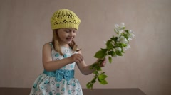 Girl shaking a blooming apple twig - stock footage