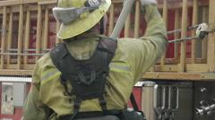 Fireman Pulls Hose off Truck CU Stock Footage