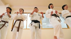 Japanese kids practicing karate in a gym Stock Footage