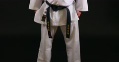 Japanese kid in karate uniform on black background Stock Footage
