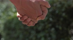 Close-up of male couple holding hands downtown Tokyo Stock Footage