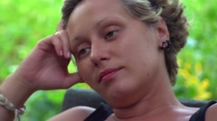 Woman resting in park Stock Footage