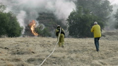 Photographer with Firefigters at Wildfire Stock Footage