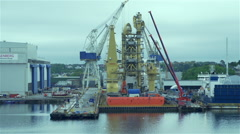 Movement along the dock with the ship and cranes Stock Footage