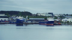 Movement along the harbor with ships in Norway Stock Footage