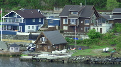 Movement along the Norwegian houses on the seafront Stock Footage