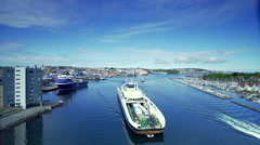 Ship passes along canal in Stavanger Norway Stock Footage