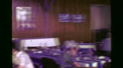 1977: Fancy restaurant with blue and white stripped table cloths and floors. - stock footage