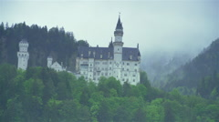 beautiful castle in Germany high in the mountains shrouded in mist - stock footage