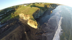 Aerial drone shot of cliffs and coastal erosion at Kai Iwi beach, New Zealand Stock Footage