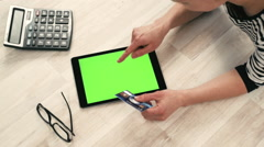 Woman with tablet pc and credit card Stock Footage