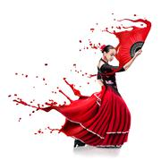 Young woman dancing flamenco with paint splashes isolated on whit Kuvituskuvat