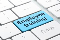 Studying concept: Employee Training on computer keyboard background - stock illustration