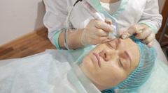 Cosmetologist applying permanent make up on eyebrows- eyebrow tattoo - stock footage