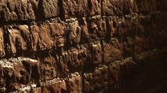 Panorama of the walls of red brick ,in the beam of light - stock footage