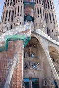 Frontal view of this architecture masterpiece, La Sagrada Familia - stock photo