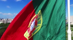 Portuguese Waving Flag in Eduardo VII Park in Lisbon, Portugal aerial view Stock Footage