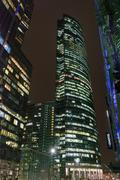 Light at night windows of skyscrapers - stock photo