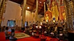 Chiang Mai, Thailand. Circa  Couple praying to Buddha in Wat Stock Footage