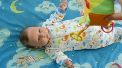 Infant Boy Playing With Colorful Toy - stock footage