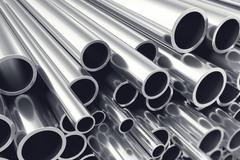 Heap of shiny metal steel pipes with selective focus effect. 3d illustration Stock Illustration
