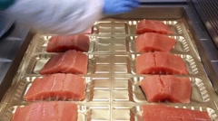 Packing salmon under pressure Stock Footage