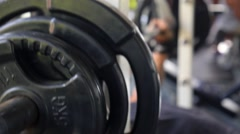 Man with Dumbbell Weight Training Muscles in Sport Gym Stock Footage