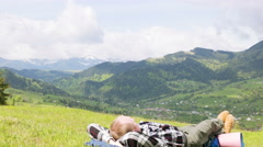 4K . Rest of  man tourist in beautiful mountains, Time lapse without birds Stock Footage