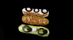 Group of French decorated dessert eclairs, top view, loop Stock Footage