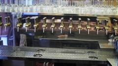 Many Beer Taps At Bar, Pan Stock Footage