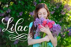 Beautiful woman with a bouquet of flowers spring park and word lilac Stock Photos
