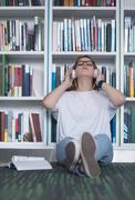 female student study in school library, using tablet and searching for inform - stock photo