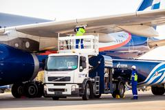 Airport Gazprom company workers refueling the aircraft Stock Photos