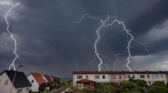Lightning Storm Over A City In Germany showing a housing development and ligh Stock Photos