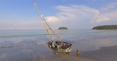 Yacht been washed aground at Kata Beach Phuket Stock Footage