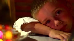 Young and sleepy boy at the restaurant table - stock footage