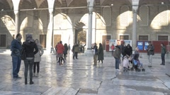 People praying blue mosque istanbul noon prayer Muslims Fatih Sultanahmet 4k - stock footage