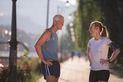 jogging couple planning running route  and setting music - stock photo