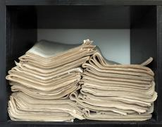 A stack of old newspapers. Stock Photos