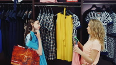 Friends bought at a clothing store, looking at the new summer dress - stock footage