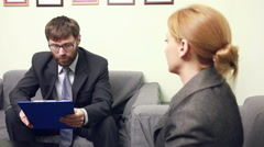 man will interview business woman. report to the Chief - stock footage