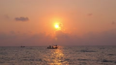 Silhouette of Asian Fishing Boat Sailing at Sunset in Sea Stock Footage