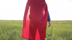 boy superhero in a field at sunset - stock footage